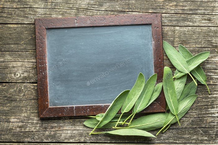 Chalkboard and sage leaves.