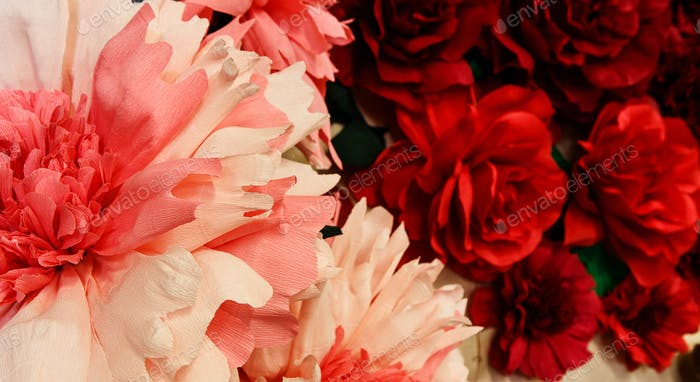 Handmade paper red and pink flowers background