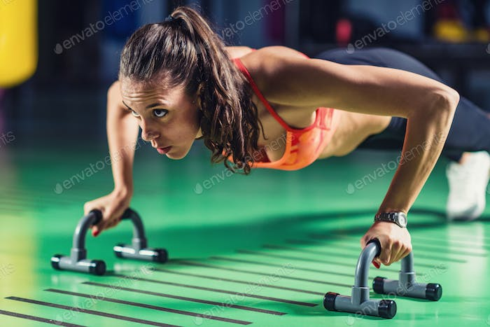 Woman doing push-ups in the gym