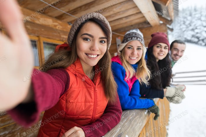 People Group Taking Selfie Photo Smart Phone Wooden Country House Terrace Winter Snow Mountain