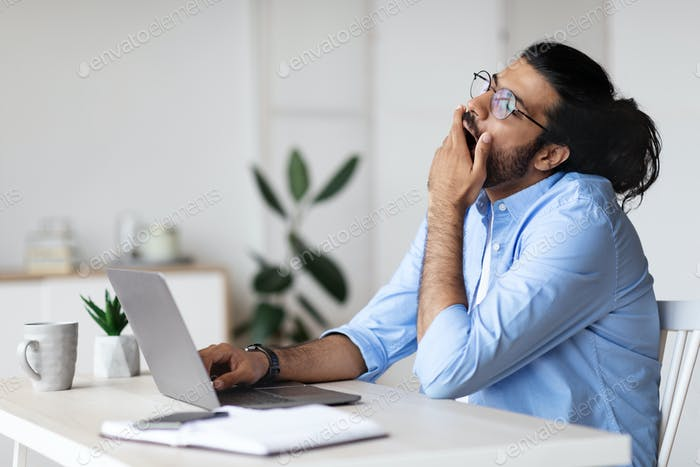 Sleepy Freelancer Guy Yawning At Workplace In Home Office, Tired Of Work