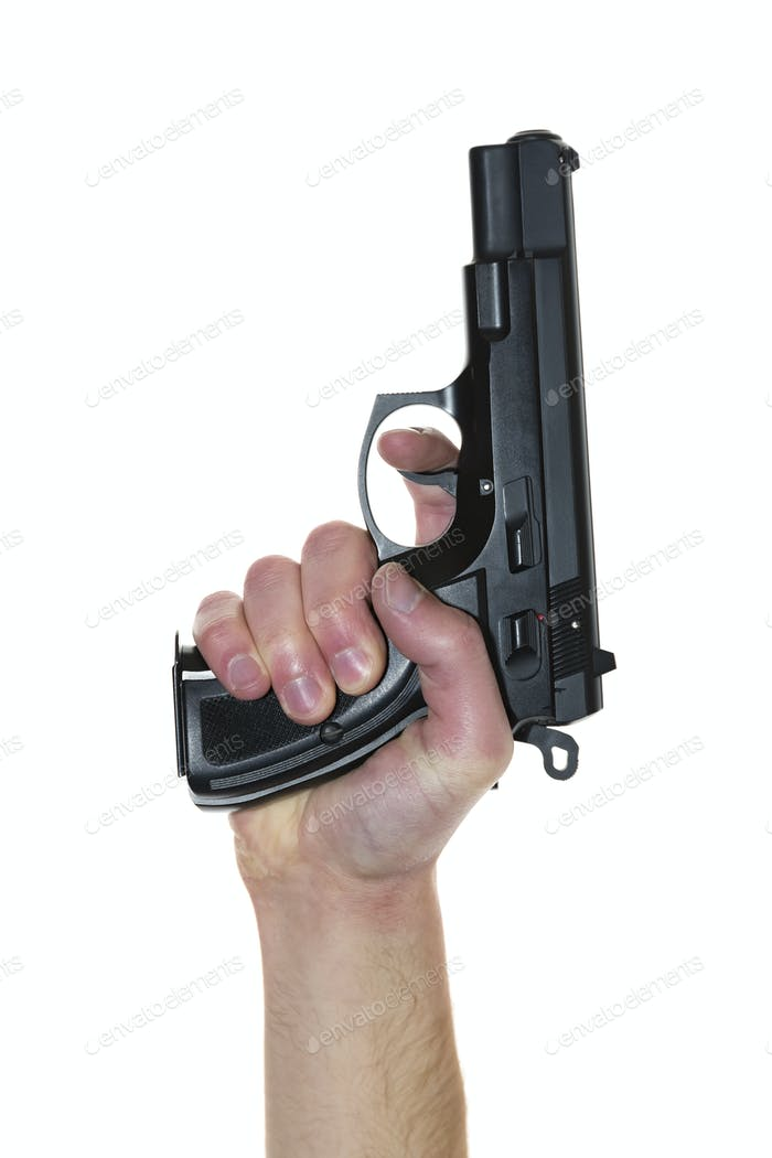 Gun in hand isolated