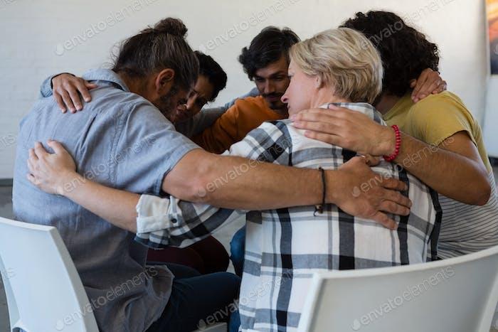 Friends huddling in art class