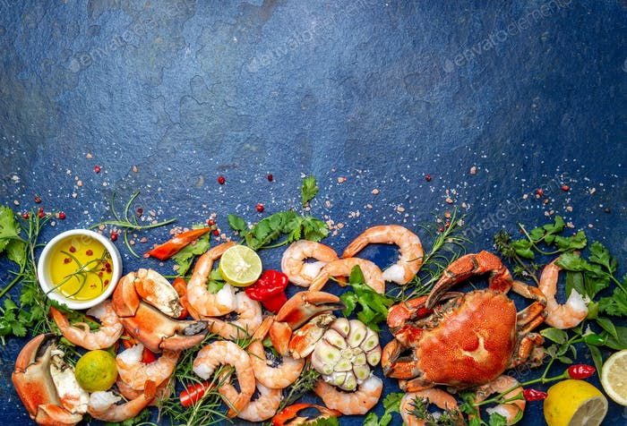 Seafood background on trendy classic blue background. Top view, copy space