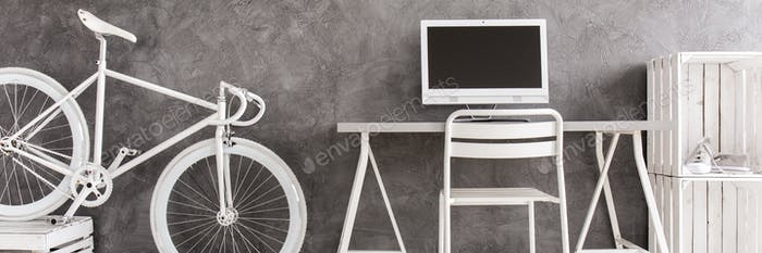 White minimalist interior and bicycle