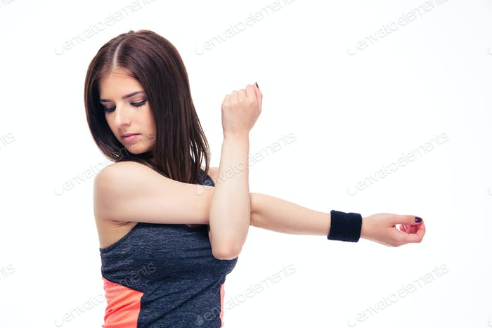 Pretty fitness woman stretching hands