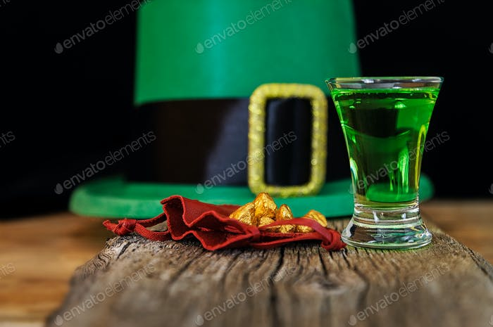 Patrick day green drink, leprechaun hat and gold prills