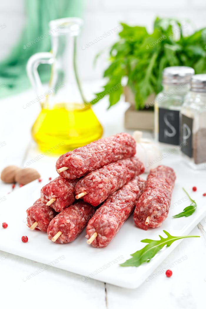 Raw lula kebab on skewers