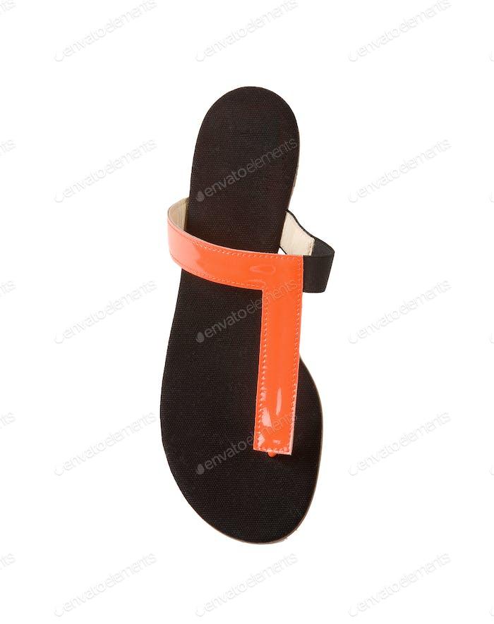 Orange patent leather flip flops