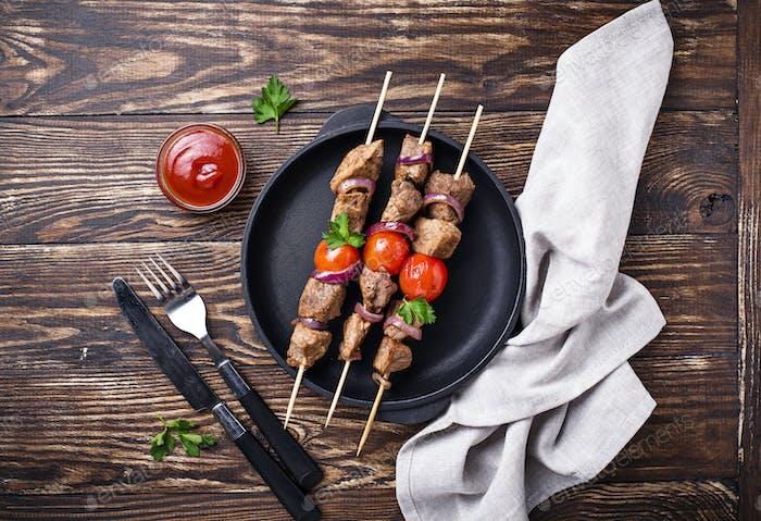Grilled shish kebab skewers with tomatoes