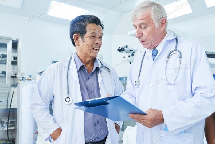 Physician listening to coworker