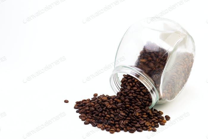 Black coffee in a glass cup and grains of coffee on a white background