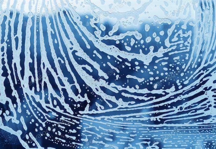 Soap foam pattern on glass