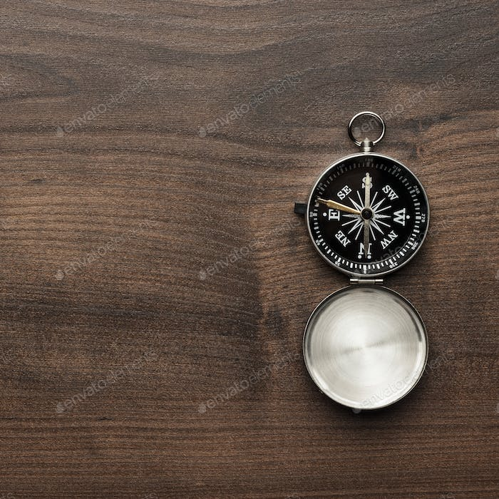 Compass On The Brown Wooden Table