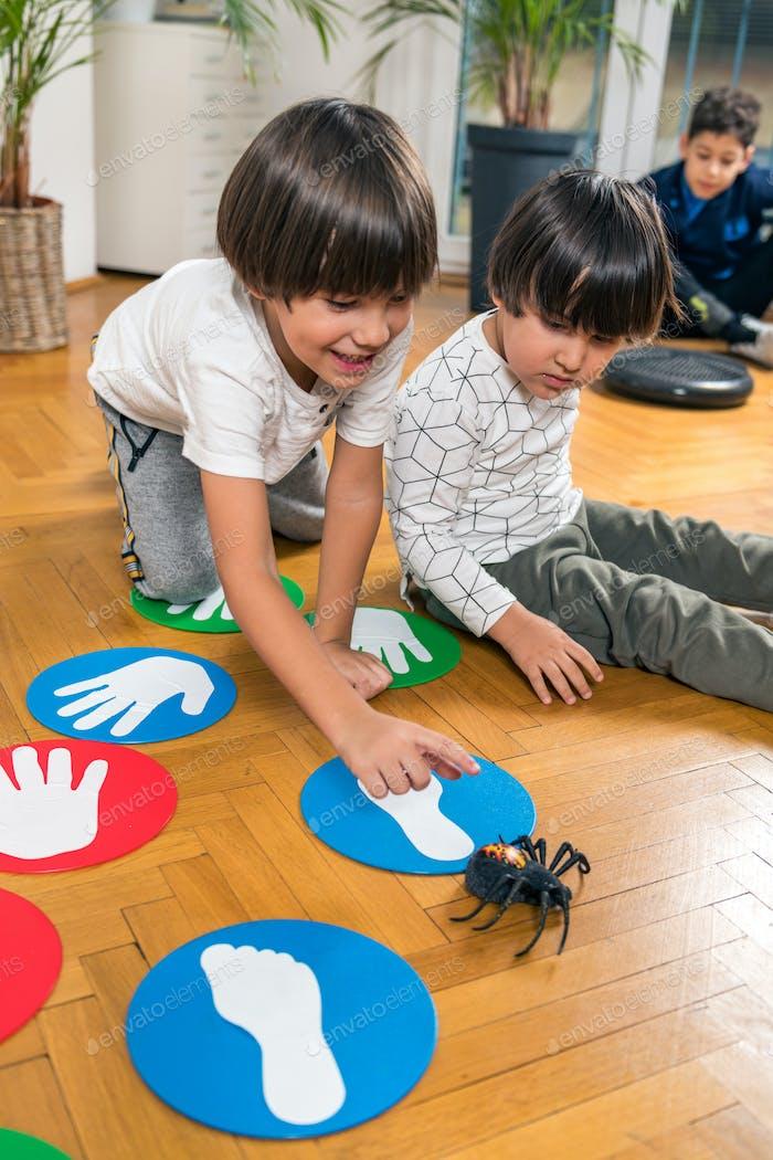 Children Playing with Toy Spider in a Kindergarten