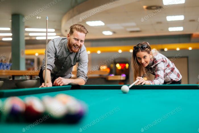 Couple dating and playing snooker