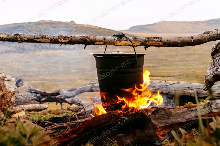 cooking food in pot an open fire