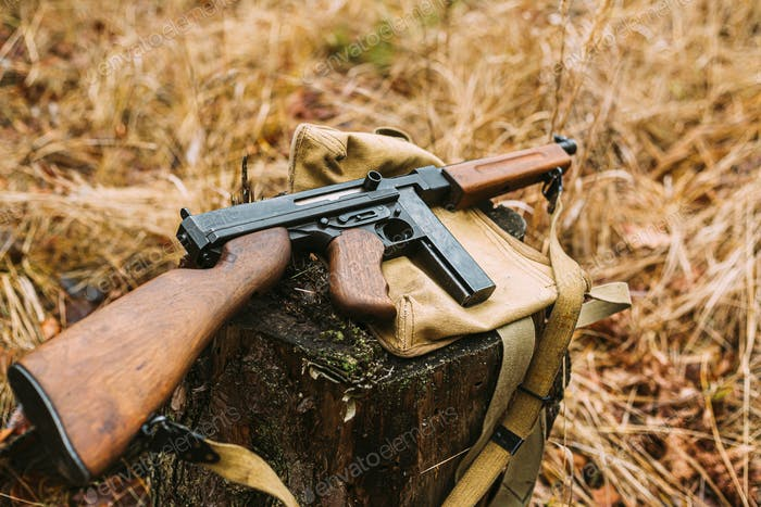 American Submachine Weapon Of World War II On Forest Sump