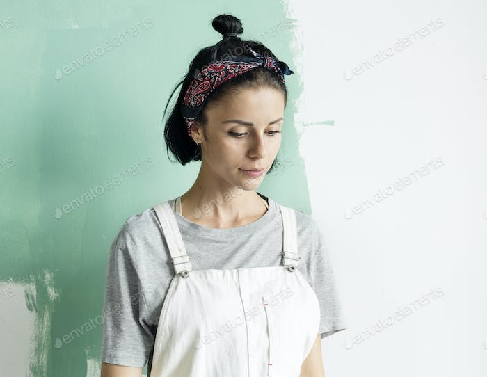 Young woman renovating the house