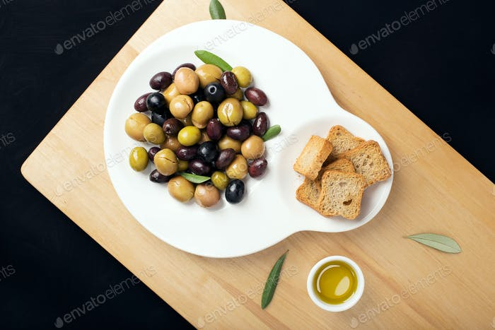 Marinated olives in fashion plate