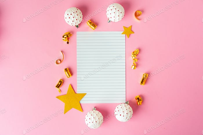 Blank sheet of paper with golden decorative stars. New year resolutions concept