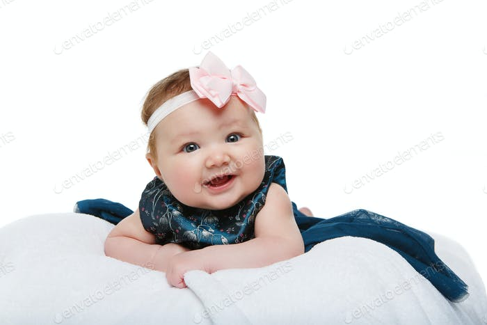 happy beautiful baby girl with bow headband