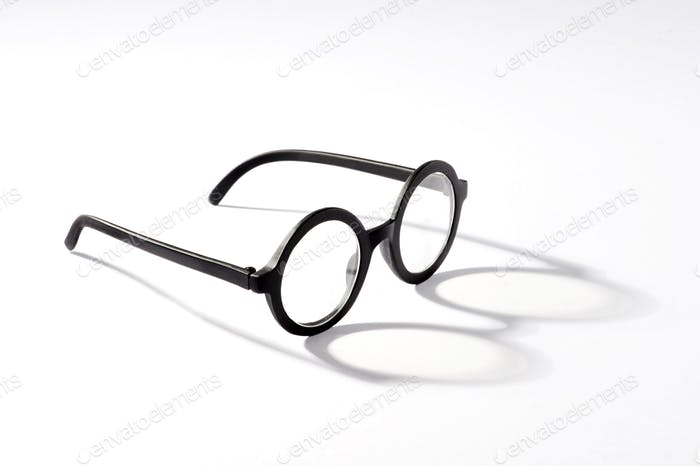 Round glasses with shadow on white background