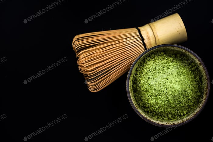 Bowl with Matcha tea and bamboo whisk
