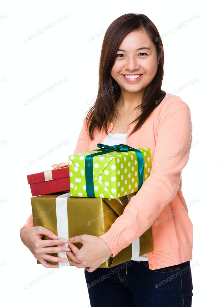Asian woman holding a lot of gift box