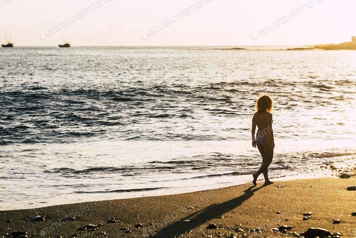 beautiful thin woman caucasian walk on the shore