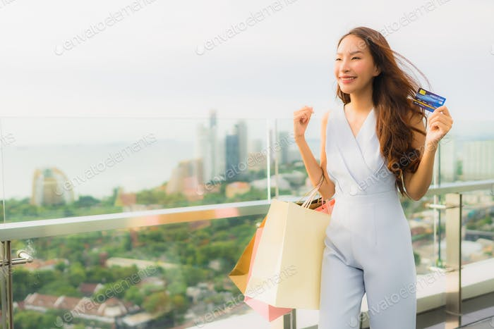 Portrait beautiful young asian woman happy and smile with credit
