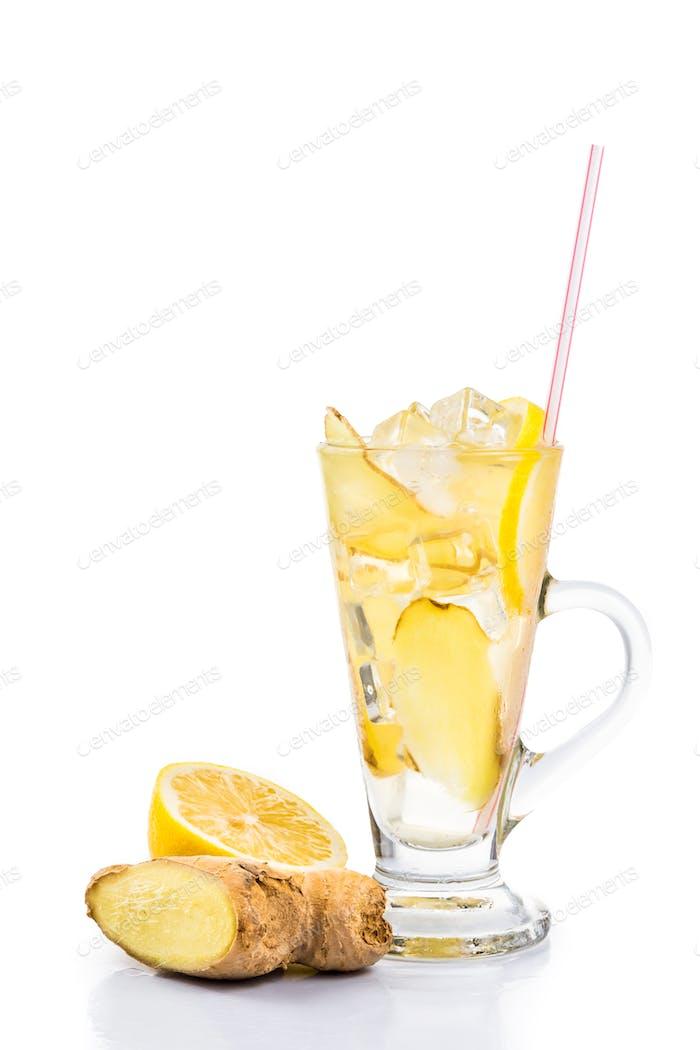 Refreshing ice cold ginger lemon tea in transparent glass vertical format