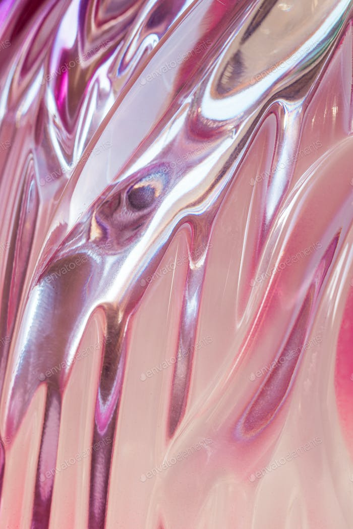 Abstract texture of colored rippled glass