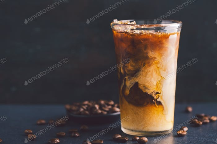 Iced coffee with cream in tall glass
