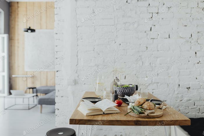 Minimal dining table with a cookbook