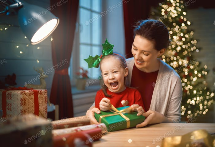 Mother and child packing gifts