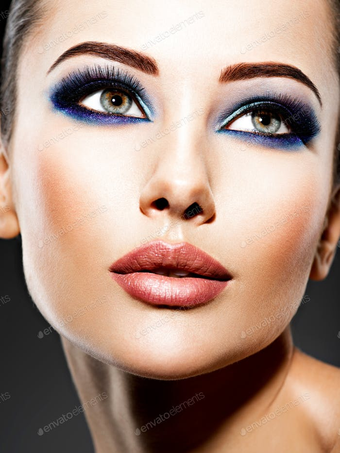 Portrait of a woman with beautiful fashion makeup.