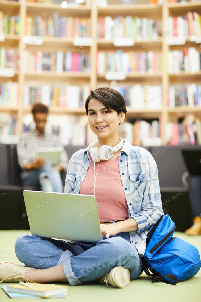 Student girl using online resource on laptop