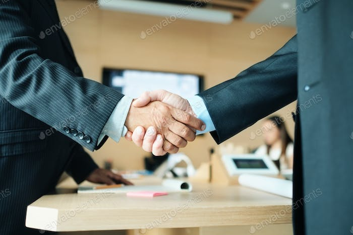 Manager Shaking Hands With Colleague After Business Meeting For Contract