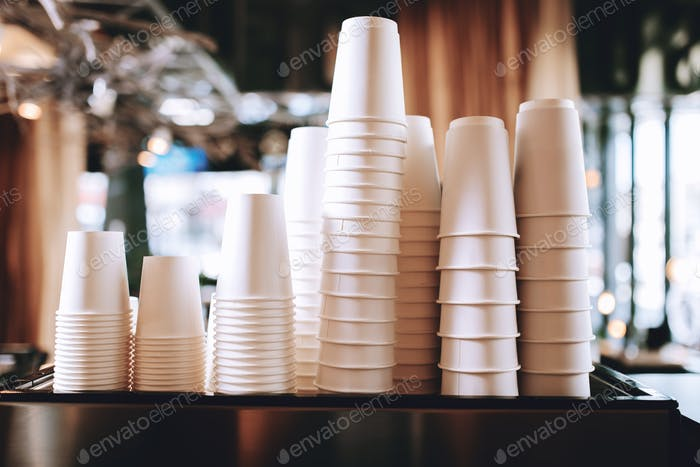 Lovely coffee glasses are standing on the top of the coffee machine in a cozy coffee shop