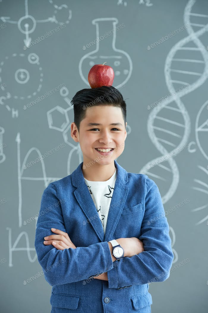 Asian Pupil with Apple on His Head