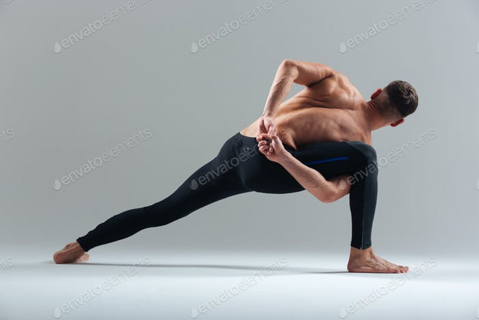 Fitness man doing yoga exercises