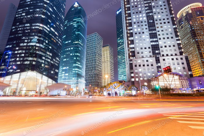 night view of city road with modern buildings in shanghai