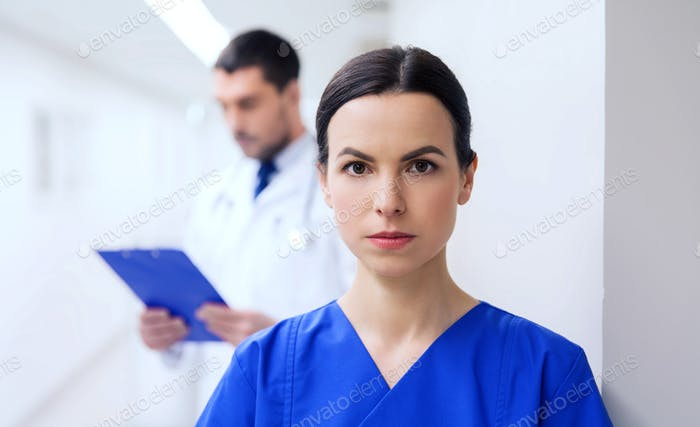 doctor or nurse at hospital corridor