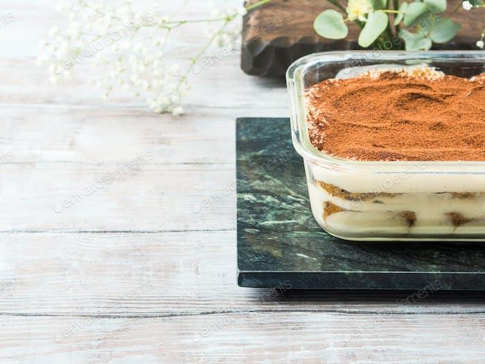 Traditional coffee tiramisu dessert in glass dish