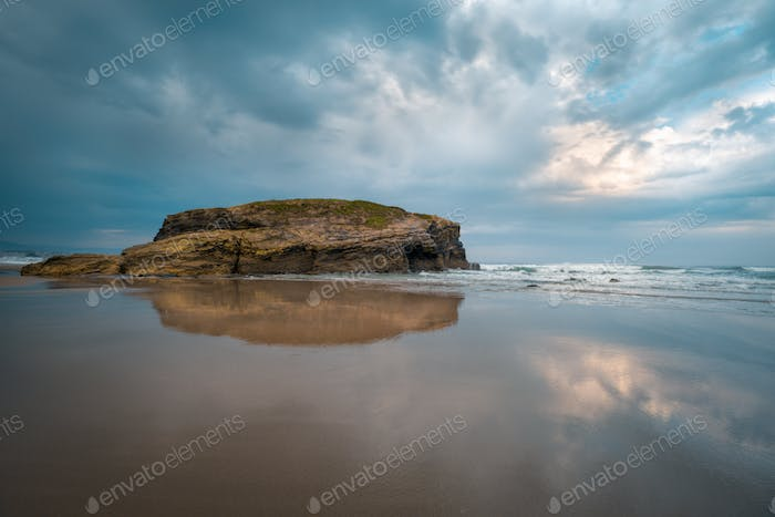Cloudy sky and low tide at As Catedrais beach