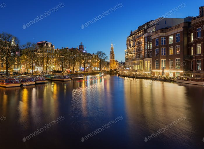 Beautiful night cityscape with traditional old houses in Amsterd
