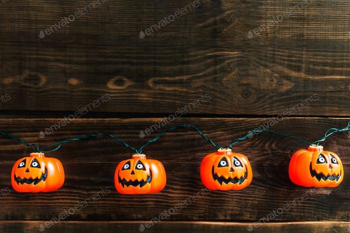 Halloween pumpkin heads on wooden background