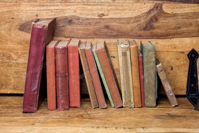 old books on the wooden bookshelfs, vintage