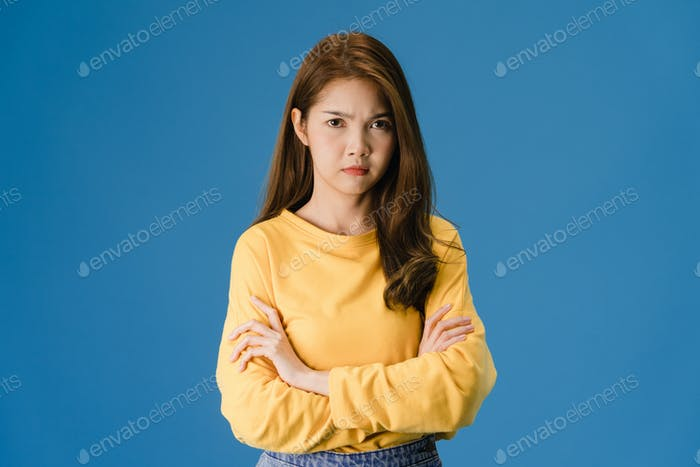 Young Asia lady with negative expression, excited screaming, angry and looking at camera.